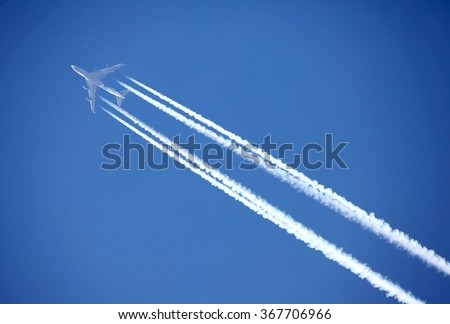 shot of a jet plane high in the blue skies - stock photo