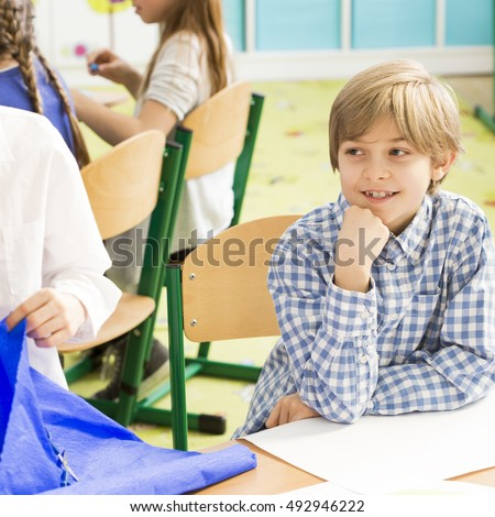 Shot of a little boy sitting in a classroom