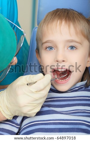 Shot of a little boy with a doctor in a dental surgery. Healthcare, medicine. - stock photo