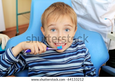 Shot of a little boy with dentists in a dental surgery. Healthcare, medicine. - stock photo