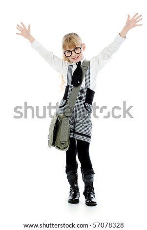 Shot of a little girl in glasses with her school bag. Isolated over white background.