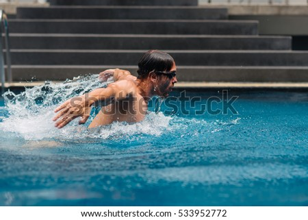 Shot of a male swimmer doing the butterfly stroke