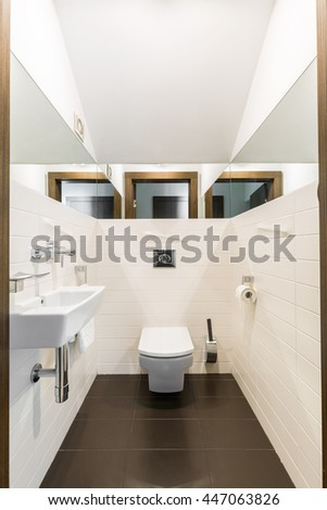 Shot of a modern bathroom with mirrors on the walls
