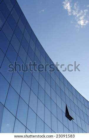 Shot of a modern building, with sky and clouds