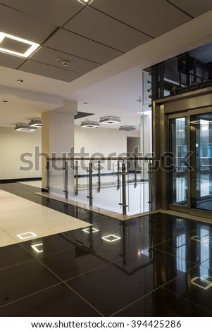 Shot of a modern hall with an elevator