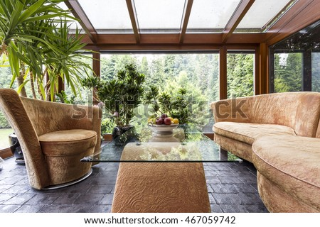 Shot of a modern stylish living room with beige furniture