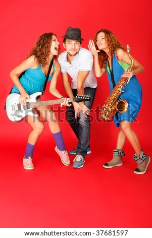 Shot of a musical band playing their instruments with great emotions. - stock photo