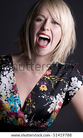 Shot of a Pretty Blonde Woman Shouting - stock photo