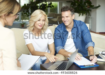 Shot of a professional businesswoman presenting investment advise to her clients.