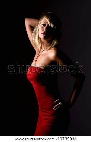 Shot of a Sexy Blonde Girl in Strapless Red Dress - stock photo