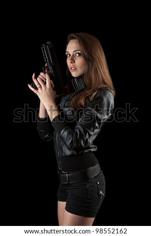 Shot of a sexy girl posing with guns isolated in black - stock photo