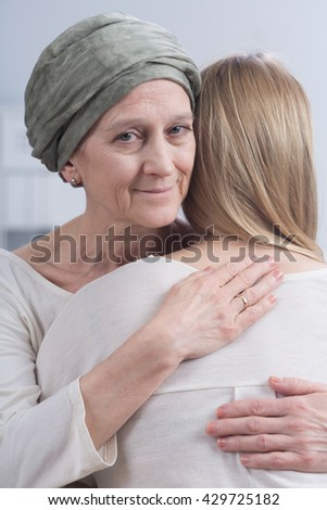 Shot of a sick mother hugging her daughter