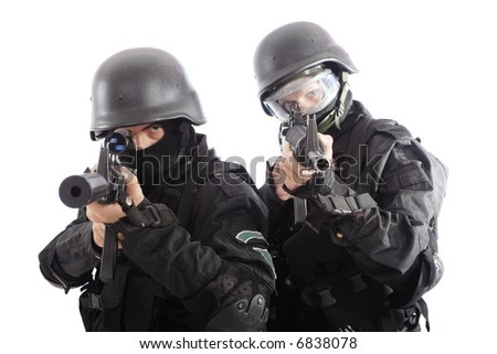 Shot of a soldier holding gun. - stock photo