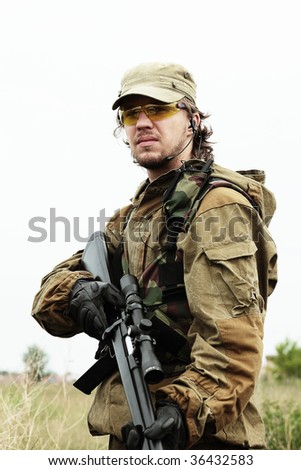 Shot of a soldier holding gun. Uniform conforms to special services. - stock photo