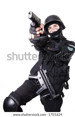 Shot of a soldier holding gun. Uniform conforms to special services(soldiers) of the NATO countries. Shot in studio. Isolated with clipping path. - stock photo