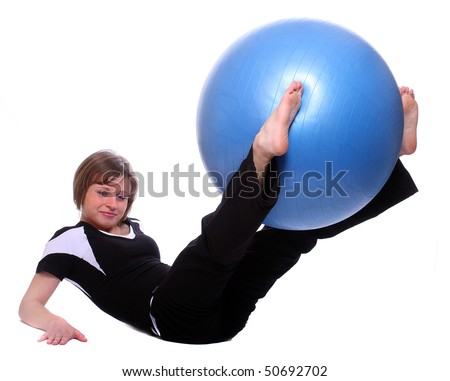 Shot of a sporty young woman with blue pilates ball on white background.