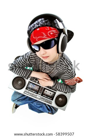 Shot of a trendy teenager listening to music in headphones. Isolated over white background. - stock photo