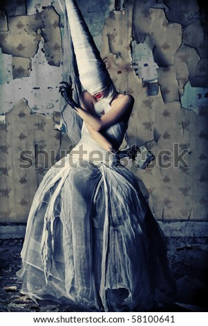 Shot of a twilight girl in white dress. Halloween, horror.