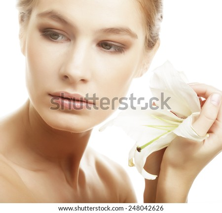 Shot of a young beautiful woman with a lily flowers - stock photo
