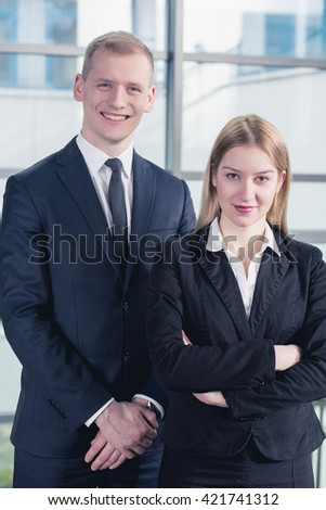Shot of a young businesspeople standing together and smiling at the camera