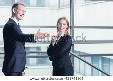 Shot of a young smiling businessman and his colleague