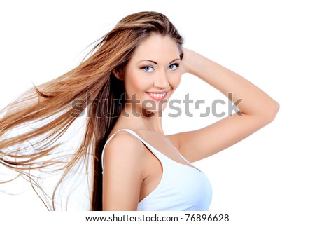 Shot of an attractive young woman in white lingerie. Isplated over white background.