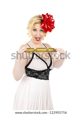 Shot of an ecstatic party girl holding a noise maker on white