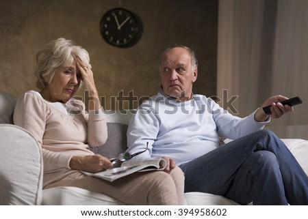 Shot of an elderly couple sitting on a sofa