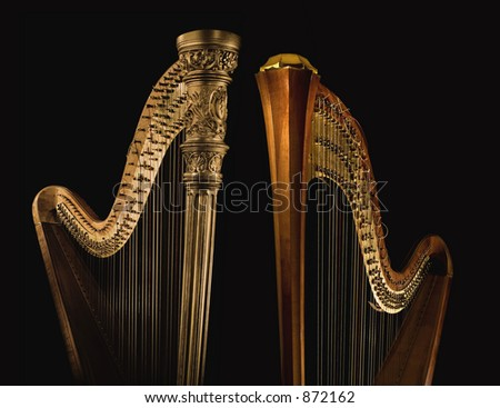 Shot of ancient harp of last century  beginning on the black background. - stock photo