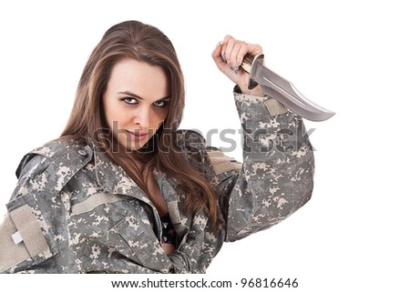 Shot of attractive girl in military uniform holding a knife - stock photo