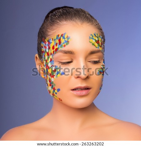 shot of beautiful woman with bright stylish make-up with closed eyes - stock photo