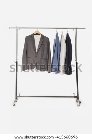 shot of business man suit clothes hanging - stock photo