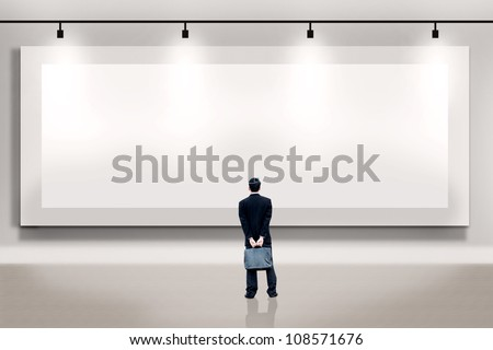 Shot of businessman looking at large empty billboard. Copy space available  for your own work - stock photo
