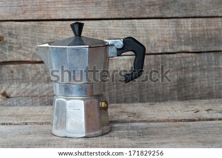 Shot of coffee maker, espresso machine on the table - stock photo