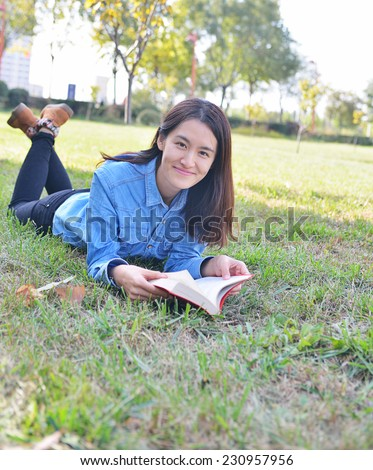 shot of college student studying on campus - stock photo