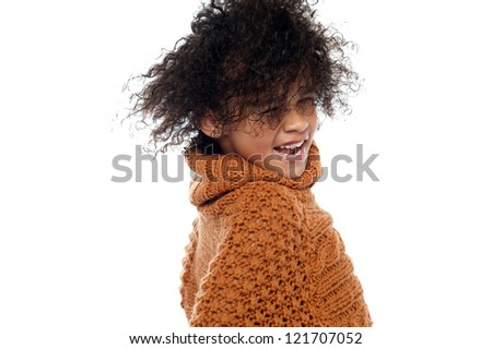 Shot of curly haired girl having a great time. Hair dancing in air. - stock photo