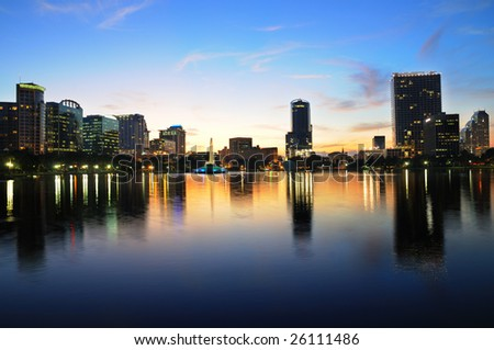 Shot of downtown Orlando from Lake Eola just after sunset - stock photo