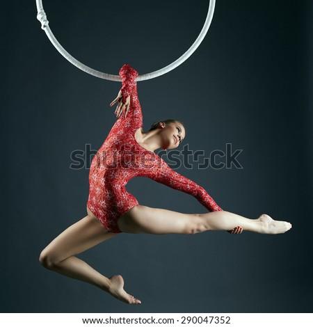 Shot of graceful female aerialist posing at camera - stock photo