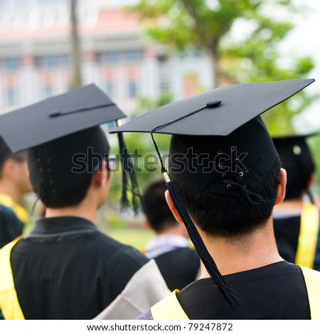Shot of graduation caps during commencement. - stock photo