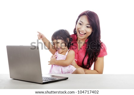 Shot of happy young mother and daughter with ultrabook laptop computer isolated on white - stock photo