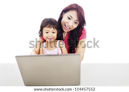 Shot of happy young mother protect her daughter to enjoying entertainment on internet - stock photo