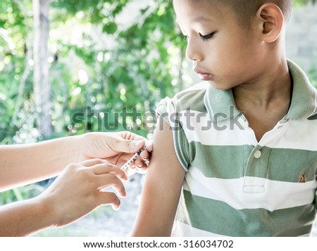 Shot of human hands making an injection with a syringe  - stock photo