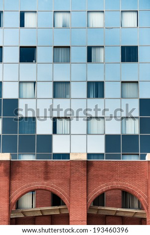 Shot of modern building midday with many windows - stock photo