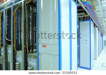 shot of network cables and servers in a technology data center Look at my gallery for more center. - stock photo