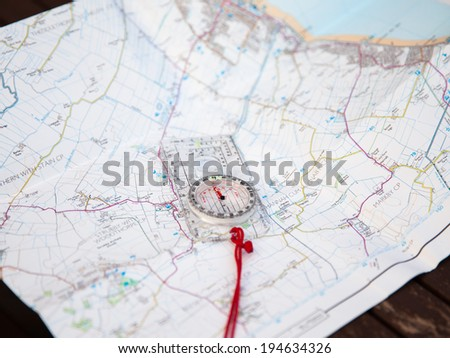 Shot of Orienteering compass on string - stock photo
