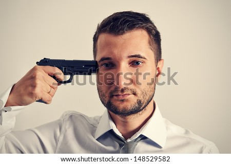 shot of quiet businessman with gun