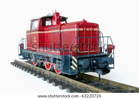 Shot of red model railway over white background.
