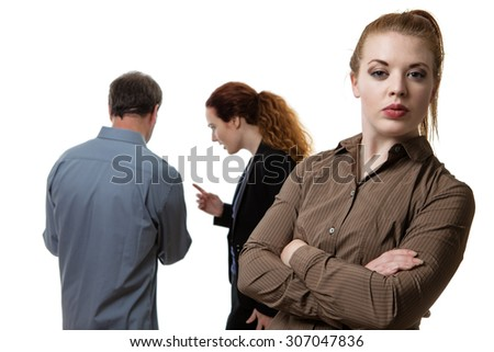 shot of three business people with one stand in front as the main focal point - stock photo