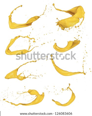 Shot of yellow paint splashes, isolated on white background - stock photo