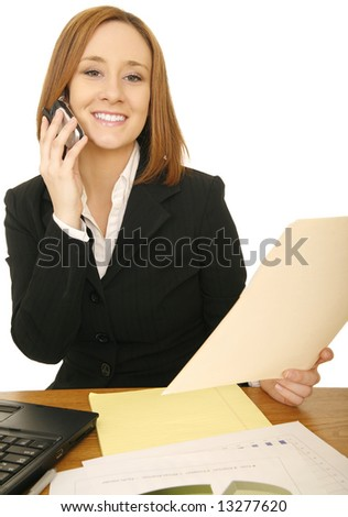 shot of young caucasian business woman on the phone and holding folder - stock photo